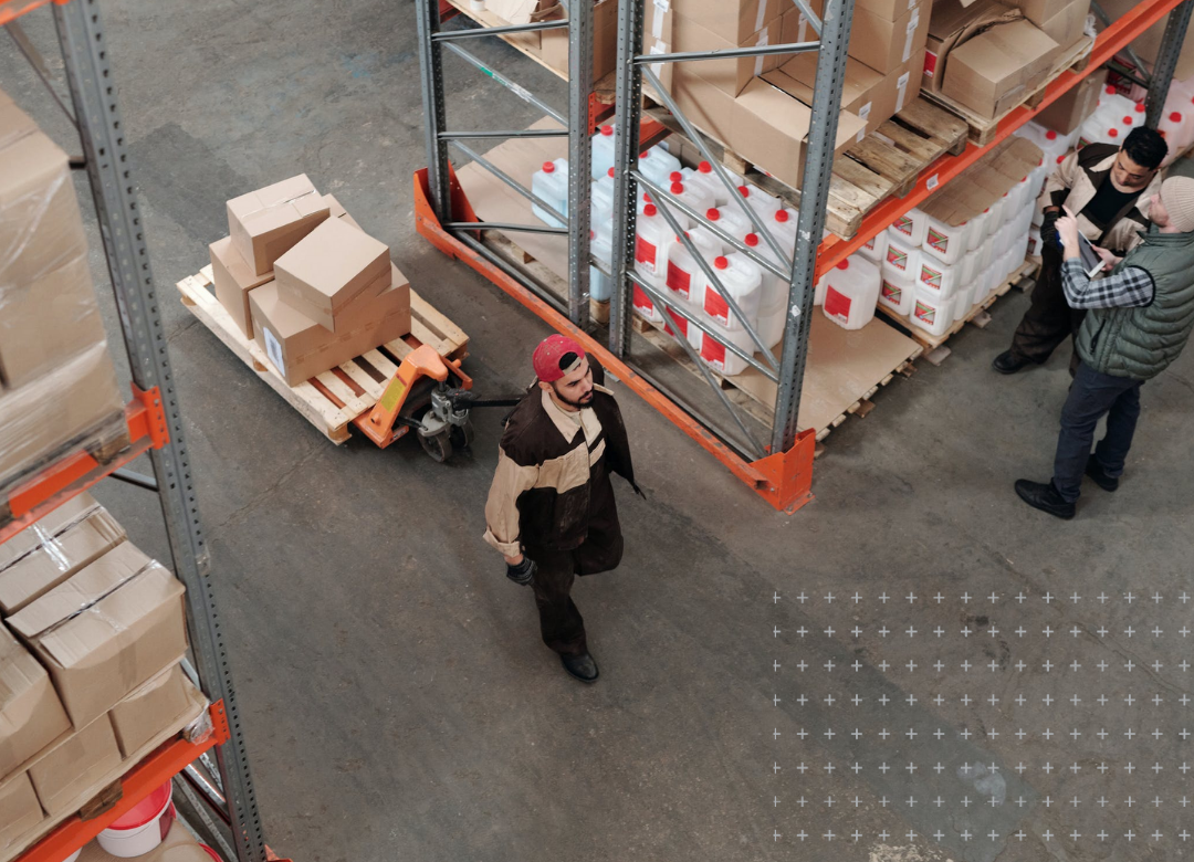 Image of men working in a large warehouse